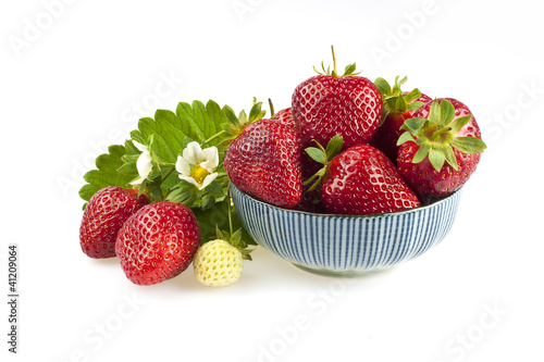 Fresh strawberries with leaves and flowers