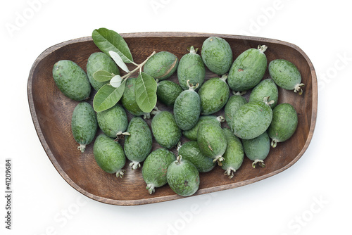 Feijoas in wooden bowl