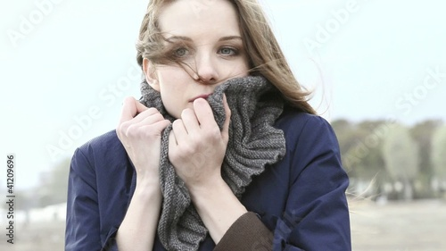 Young woman on the beach on a windy day; Full HD Photo JPEG