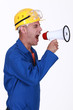 Angry builder shouting through megaphone