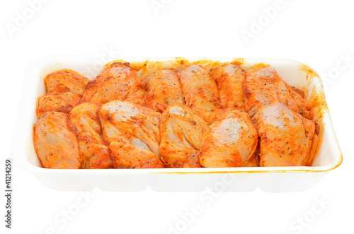 Raw chicken wings marinated