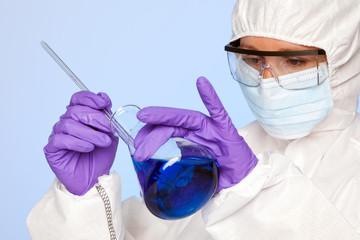 Lab technician with a chemical flask