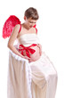 young pregnant woman with red wings