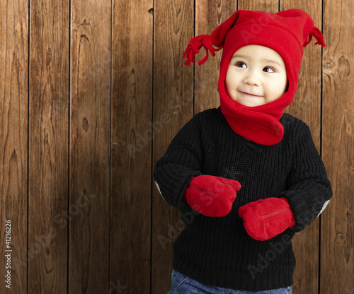 portrait of an adorable kid smiling wearing winter clothes again
