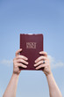 Married Man Holding Bible to Sky