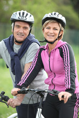 Senior couple having a bike ride