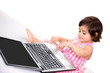 Baby on laptop looking busy, with copy space