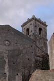 Old church belfry in Savoca village, Sicily, in the evening