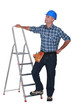 Manual worker stood with ladder