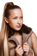 woman with long straight hair in brown jacket