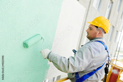 canvas print picture builder facade painter at work