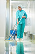 Woman cleaning hospital hall - 41224067