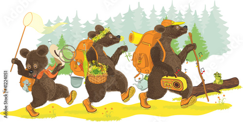 Family of bears traveling on forest.