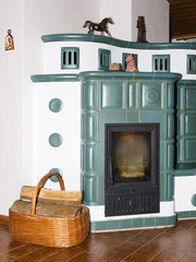Old fashioned tile stove with basket