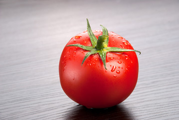 Tomato on dark  background