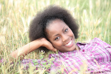 Woman laid relaxing in field