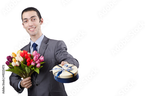 Businessman with giftbox and flowers