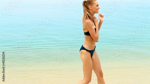 Young woman spending free time on the tropical beach