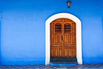 Wooden door and blue wall