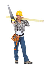 Woman carrying a handsaw and timber