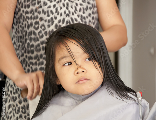 Young girl getting a haircut by supakitmod, Royalty free stock photos