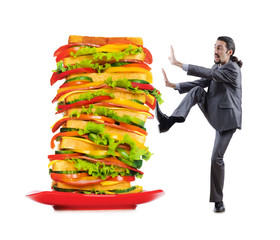 Man and giant sandwich on white