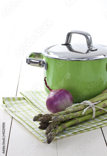 Green pot and asparagus