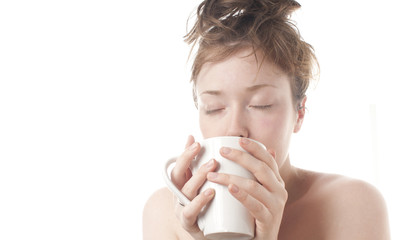 Young girl drinking coffee in the morning with white background