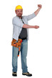 Tradesman holding up an imaginary board