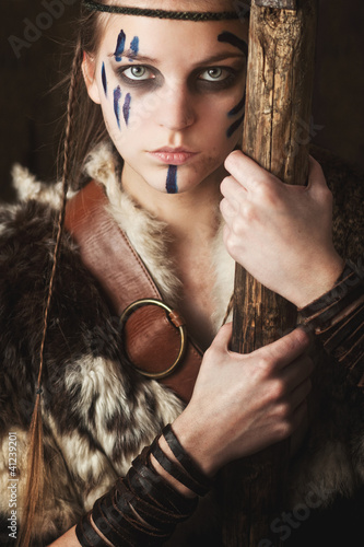 Female warrior holding staff