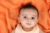 Baby boy with orange background