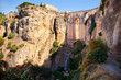 New bridge and falls in Ronda white village. Andalusia, Spain.