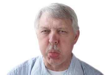 an older man blows a raspberry in a rude gesture