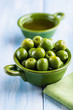 Green Sant Agostino Olives in a small bowl