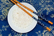 cup of rice basmati with chopsticks