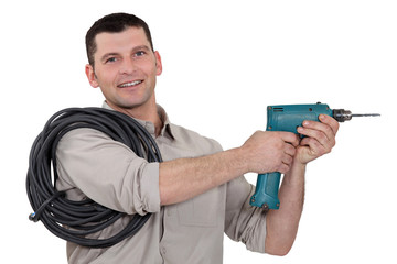 Man with cable and drill
