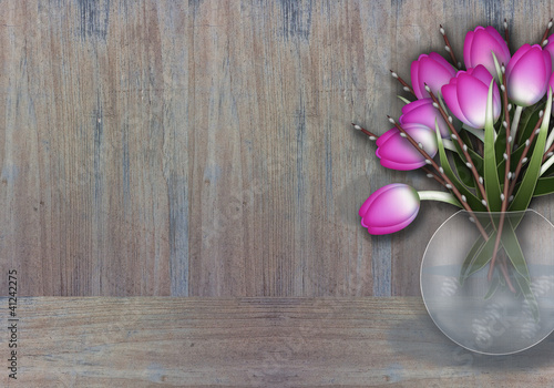 Purple tulips in a wase wooden texture background