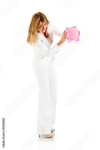 Woman emptying a piggybank