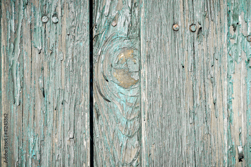 Close up old weathered planks with peeling paint