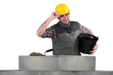 Man building stone wall