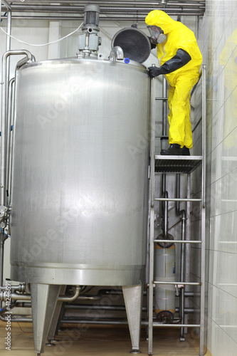 technician controlling industrial process in factory