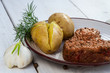 Roast beef steak served with potatoes and dill
