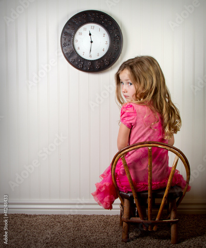 little girl in time out or in trouble looking