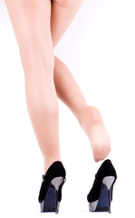 Sexy womanish leg in shoe isolated on white background.