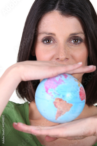 Woman holding miniature globe
