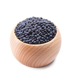 wooden bowl full of beluga lentils isolated on white