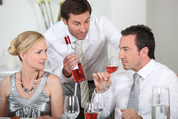 Couple sat drinking wine