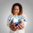 """Businesswoman hand holds globe and social network""""Elements of th"""