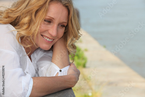 Smiling woman on a boardwalk