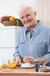 Woman juicing an orange